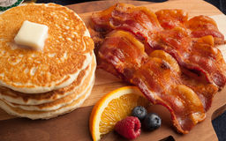 Hearty country breakfast of bacon and pancakes Royalty Free Stock Images