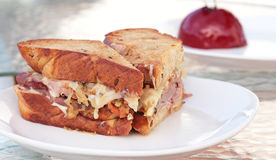 Hearty Deli Sandwich. Hearty sandwich on freshly baked toasted bread with corned beef and sauerkraut stock photography