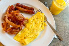 Hearty eggs, bacon and sausage breakfast Royalty Free Stock Image