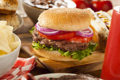 Hearty Grilled Hamburger with Lettuce and Tomato Royalty Free Stock Photography
