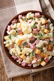 Hearty Hawaiian salad with pasta, ham, pineapple, onion, cheddar. Cheese dressed with mayonnaise close-up in a bowl on the table. Vertical top view from above stock photos