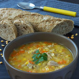 Hearty Homemade Pea Soup. Hearty, thick and most of all delicious! Served with a slice of bread Stock Images