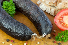 Hearty meat platter. With black pudding and crispy sausage Stock Photo