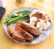 Hearty meatloaf dinner with sides. Close up photo of a hearty meatloaf dinner with sides stock image