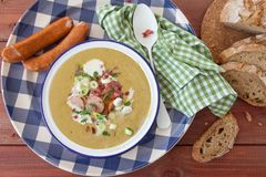 Hearty potato soup. With smoked sausages and bacon royalty free stock photos