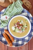 Hearty potato soup. With smoked sausages and bacon royalty free stock photography