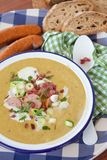 Hearty potato soup. With smoked sausages and bacon royalty free stock images