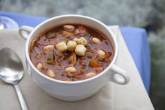 Hearty Soup. Hearty winter vegetable and white bean soup on a rainy afternoon royalty free stock photo