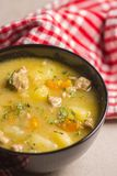 Hearty Soup Closeup in Black Glass Bowl royalty free stock image