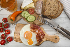 Hearty supper, fried egg and bacon on protein bread Royalty Free Stock Image