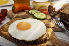 Hearty supper, fried egg on protein bread Royalty Free Stock Images