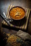 Hearty Tomato Vegetable Soup. Rustic homecooked hearty tomato vegetable soup in a wooden bowl Stock Photo