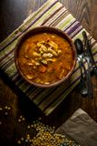 Hearty Tomato Vegetable Soup. Rustic homecooked hearty tomato vegetable soup in a wooden bowl Stock Images