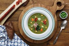 Hearty traditional Dutch pea soup with smoked sausage, rye bread and bacon. Or: `erwtensoep met rookworst, roggebrood en Stock Photos