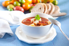 Hearty vegetable soup. With potatoes, carrots, tomatoes and other ingredients Stock Images