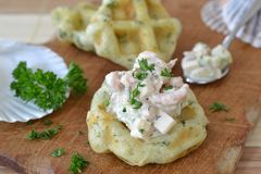 Hearty waffle with shrimp dip. Hearty Belgian waffle with shrimp dip Royalty Free Stock Photos