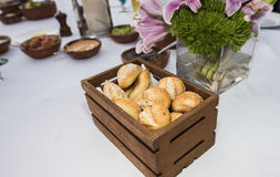 Hearty y Rolls in a Wood Basket on a Table with Mexican Food Stock Image