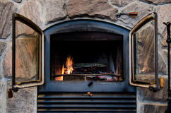 Fireplace in a rustic stone chimney Stock Images