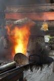 Heat in ancient metal crucible Stock Photos