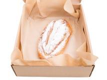 Heat apple puff cake in cardboard box. Royalty Free Stock Image