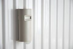 Heat cost allocator on heater Stock Photos