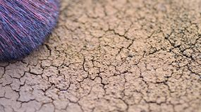 Heat-dried ground, close-up dry coffee grounds and brush. Heat-dried ground, close-up dry coffee grounds and brush royalty free stock photography