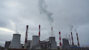 Heat electric power station and cloudy sky, 2 videos in 1. Moscow heat electric power station and cloudy sky, 2 videos in 1 clip stock footage