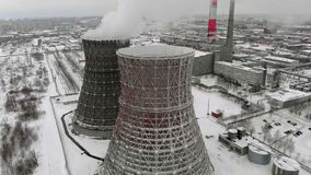 Heat electric station in winter. Aerial view. Top view, copter shoot. Thermal power in winter. Residential heat supply. Flying over the large pipes of the stock footage