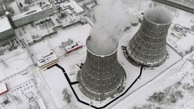 Heat electric station in winter. Aerial view. Top view, copter shoot. Thermal power in winter. Residential heat supply. Flying over the large pipes of the stock video
