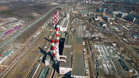 Heat electropower station with two red chimney. Shooting drone stock video footage