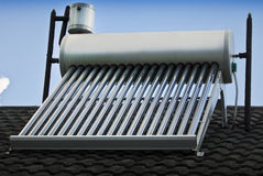 Heat Exchange - Solar Heater. Solar energy, a renewable energy source for water heating. Evacuated glass tubes, method is termed - Heat Exchange. Evacuated glass royalty free stock image