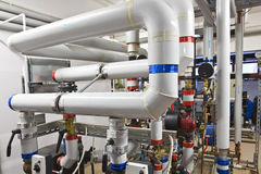 Heat exchanger room. With pipeline Royalty Free Stock Photo