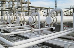 Heat exchangers in refineries. The equipment for oil refining. Heat exchanger for flammable liquids. The plant for the primary. Processing of oil stock images