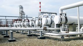 Heat exchangers in a refinery. The equipment for oil refining.  royalty free stock photos