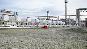 Heat exchangers in a refinery. The equipment for oil refining.  stock photography