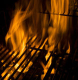 Heat. Fire burnning on a grill stock photography
