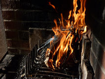 Heat. This fireplace has been used over 40 years to heat a Swedish cabin in the countryside. Nothing beats this feeling of warm air and the sound of the flames Royalty Free Stock Photos
