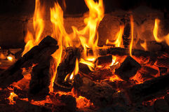 Heat and flame in the fireplace Stock Image