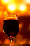 Heat in a glass. A glass of red wine with some lights as a background. I tried to make a nice bokeh effect, let's hope that I`ve succeeded Royalty Free Stock Photography