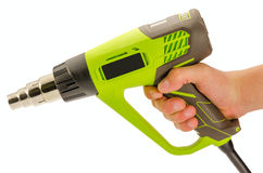 Heat Gun. Green hot air gun close-up, isolated on a white background royalty free stock photography