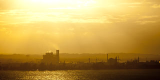 Heat, haze, and industry. Industrial area with heat and haze at dusk Royalty Free Stock Photo