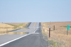 Heat Haze. On a long straight road in the plains in USA Royalty Free Stock Photo