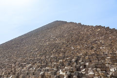 Heat haze over Great Pyramid of Giza Cairo. View up the side of Great Pyramid of Giza in Cairo Egypt on baking hot day with the heat haze and sun blinding the Royalty Free Stock Photography