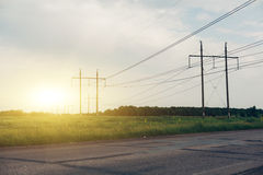 Heat haze rises as powerlines blur into the distance Stock Photos