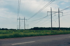 Heat haze rises as powerlines blur into the distance Stock Images