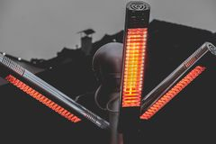 Free Heat Infrared Lamp Gas Patio Heaters With Propane In A Warm Light Pole On Street Stock Images - 167707114