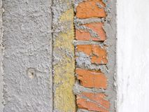 Heat isolation material stone. Stone wool between the bricks and interior wall royalty free stock image