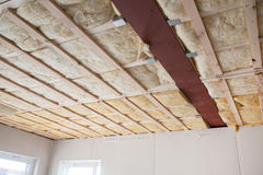 Heat isolation in a new prefabricated building. Heat insulation of a new prefabricated house with mineral wool and wood Stock Images
