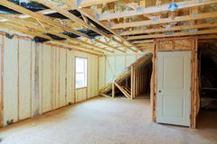 Heat isolation in new prefabricated house with mineral wool and wood. Heat isolation in a new prefabricated house with mineral wool and wood Royalty Free Stock Photos