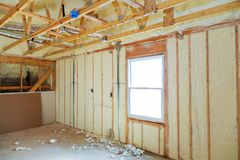 Heat isolation in a new prefabricated house with mineral wool and wood. Stock Images